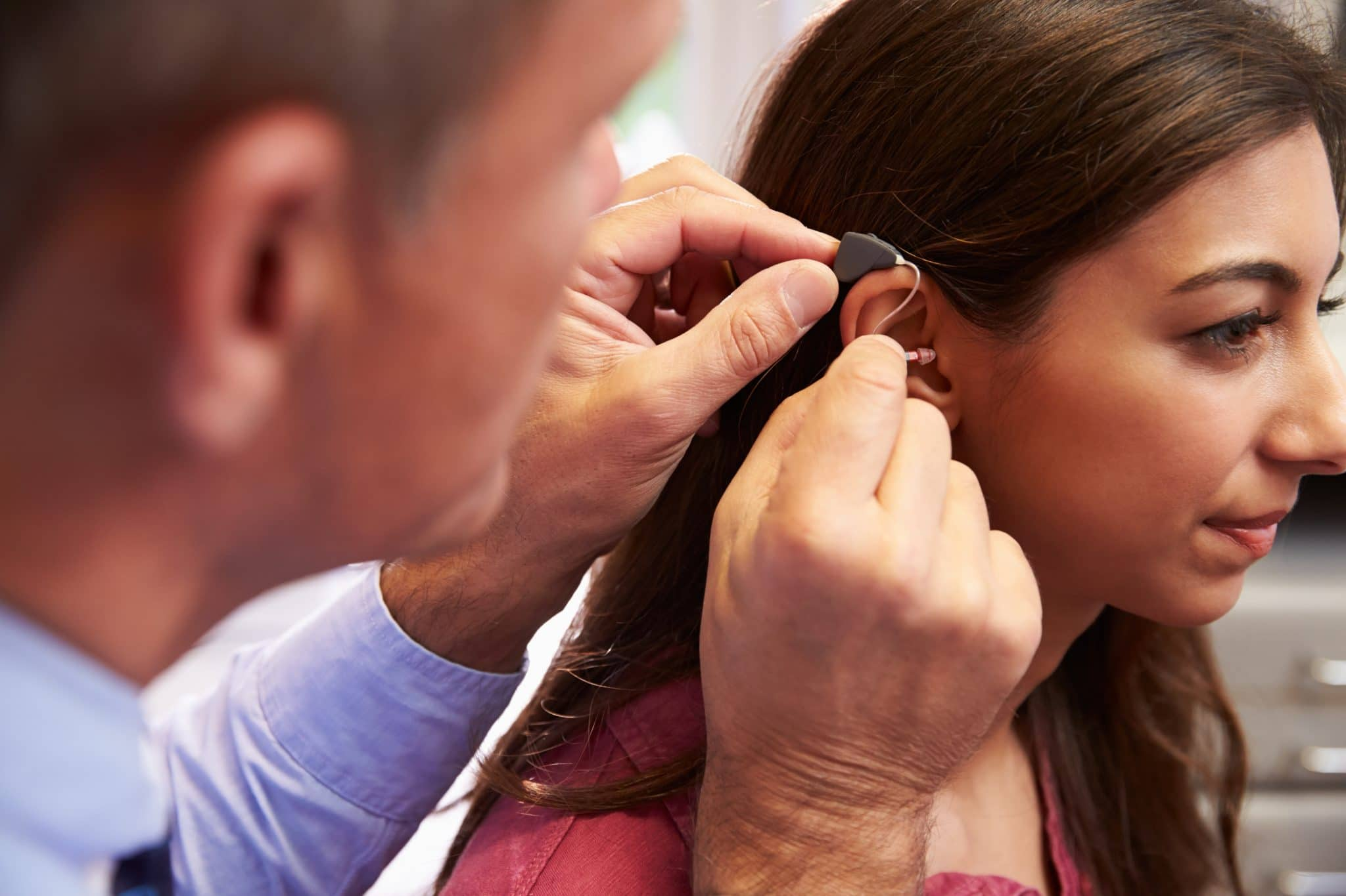 Woman gets fitted with hearing aids