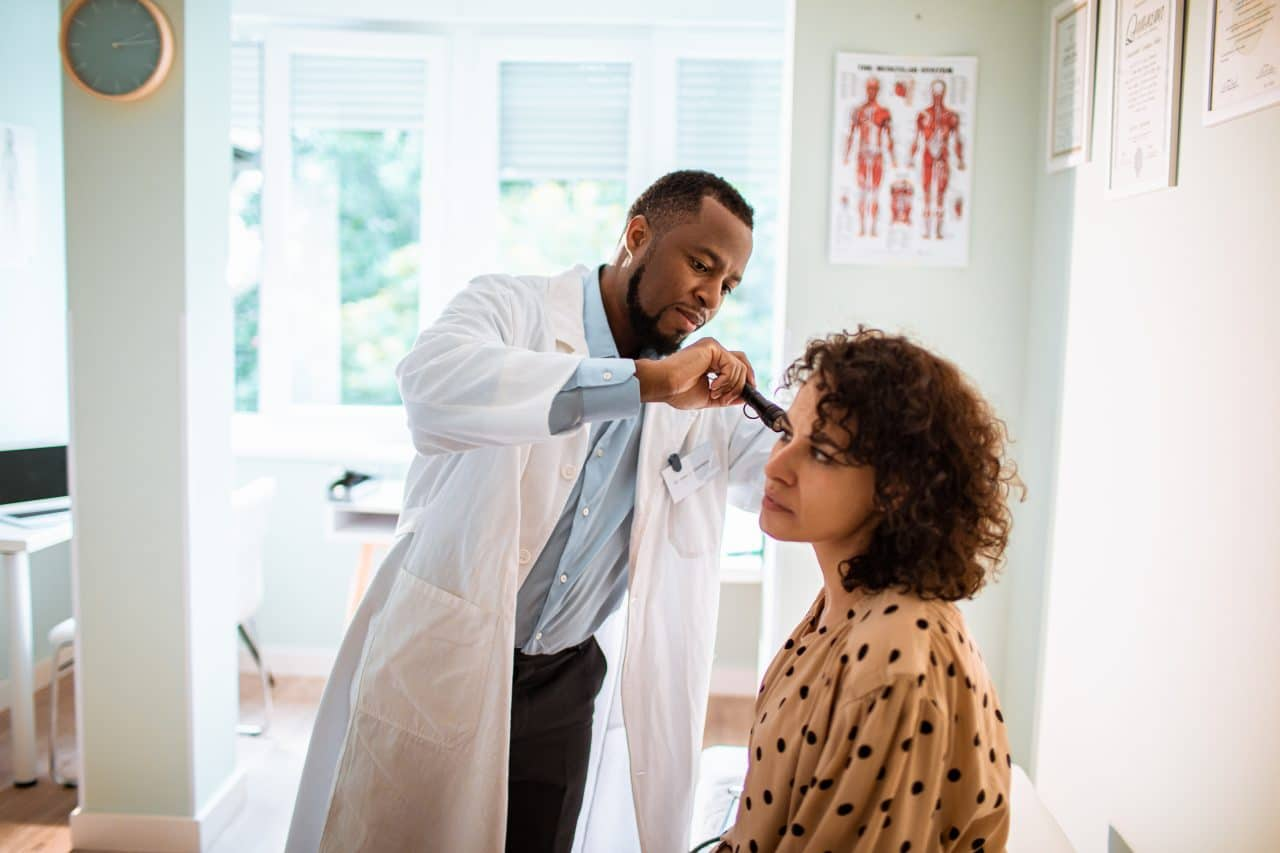 Close up of a doctor doing a medical exam on his patient