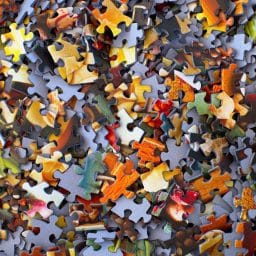 Large amount of jigsaw puzzle pieces.